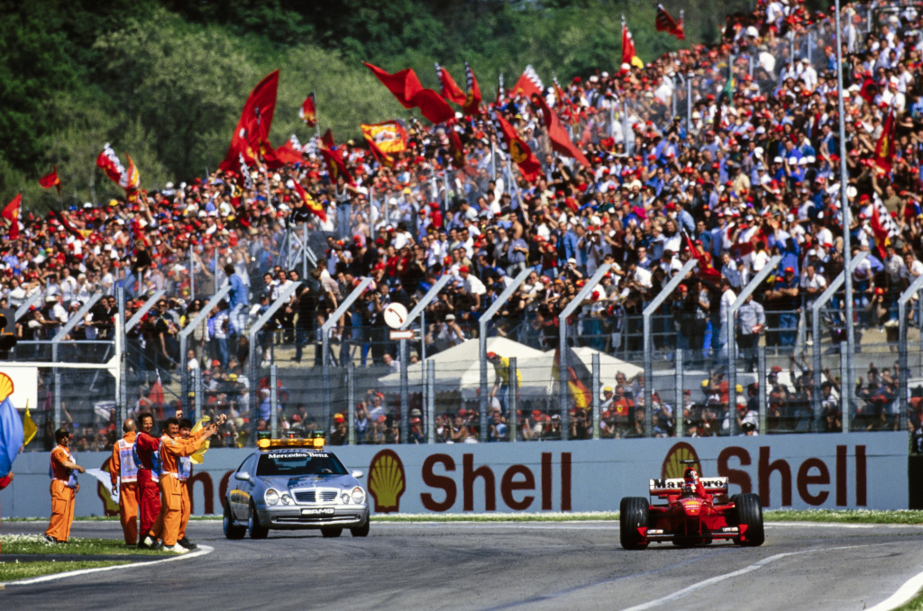 Fans celebrate as Michael Schumacher wins an F1 race at Imola.