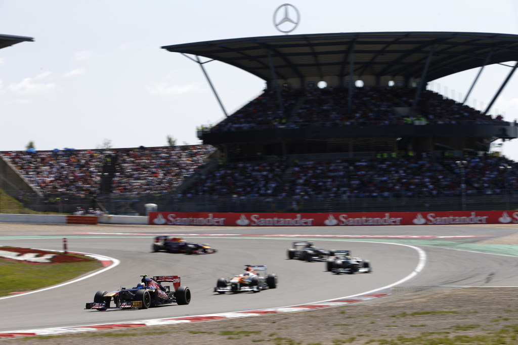 Daniel Ricciardo and Paul Di Resta during the 2013 German F1 Grand Prix