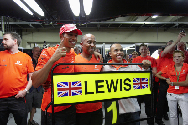 Lewis Hamilton celebrating with his father and brother