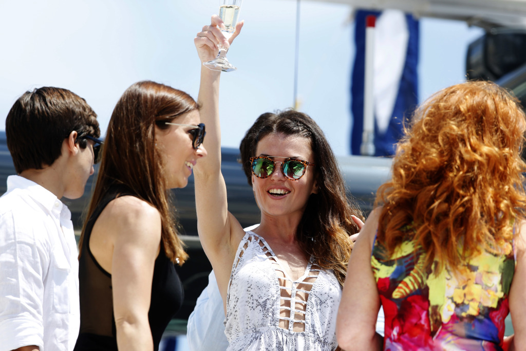 A racing fan drinking champagne on a yacht at the Monaco F1 Grand Prix