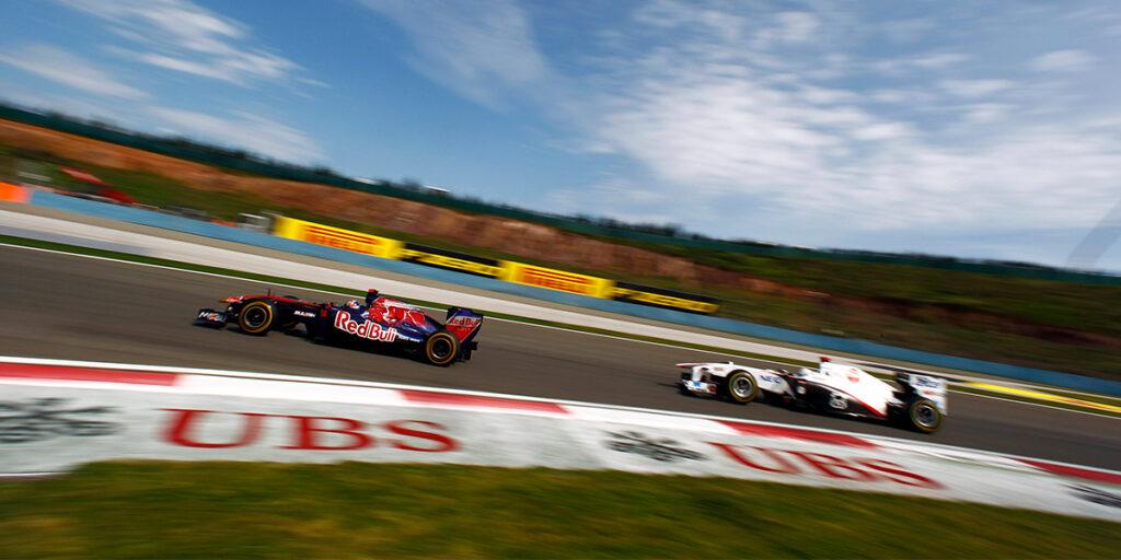 Two Formula 1 cars drive around a corner at the Turkish Grand Prix