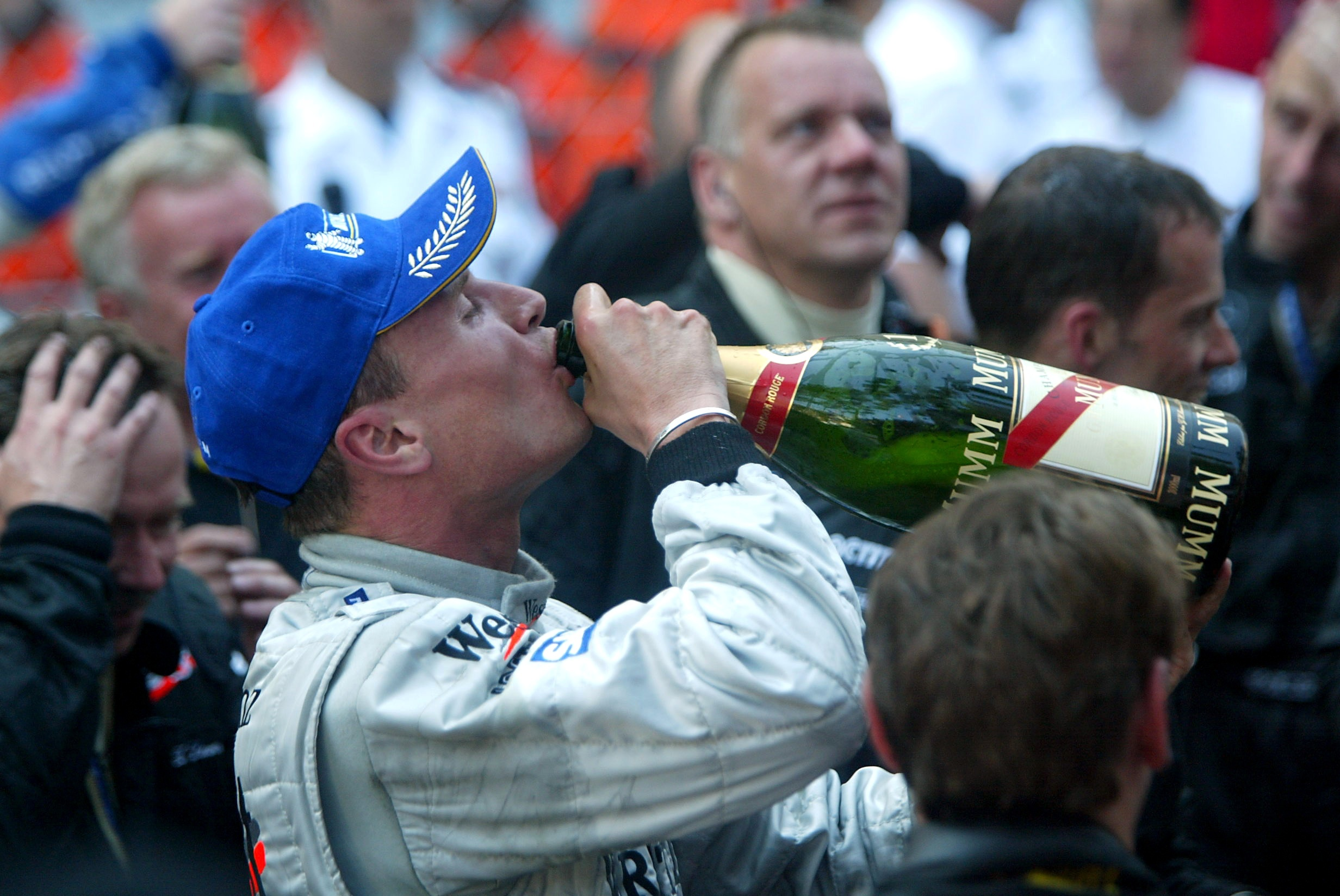 David Coulthard drinking champagne after the Monaco Grand Prix