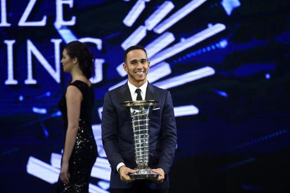 Lewis Hamilton holding a trophy