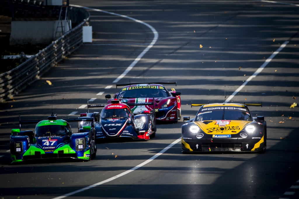Four cars on track during Le Mans.