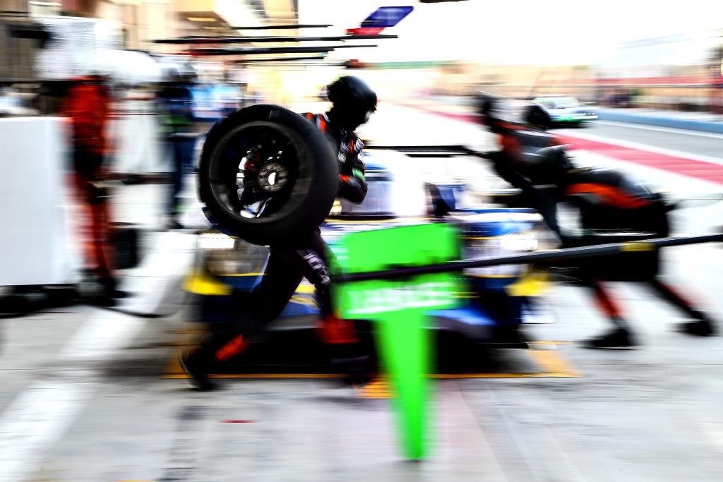 A pit crew perform a pitstop during a WEC race