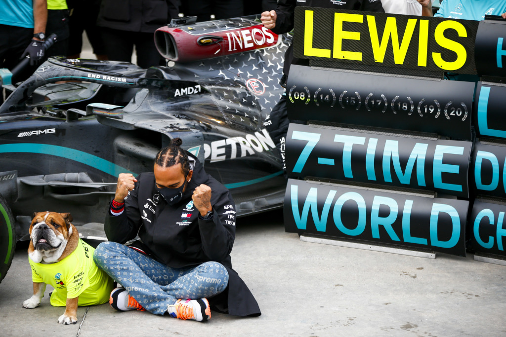 Lewis Hamilton celebrating his world championship with his dog, Roscoe