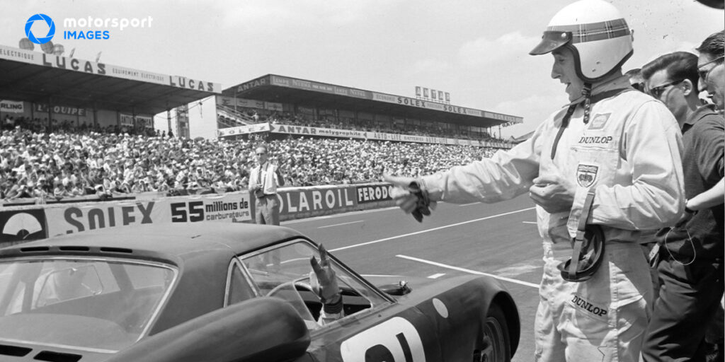 Graham Hill drives a car at the Le Mans 24 Hours