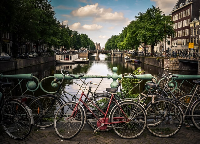 Bikes on a bridge over a canal in Amsterdam