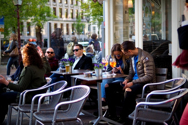 People at a coffee shop in Amsterdam
