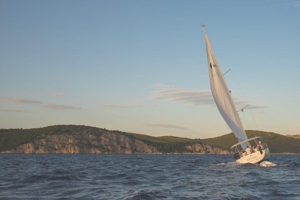 A sail boat in the sea