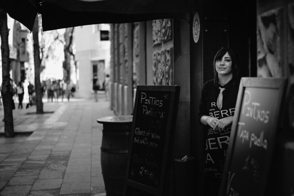 A waitress outside a bar in Barcelona