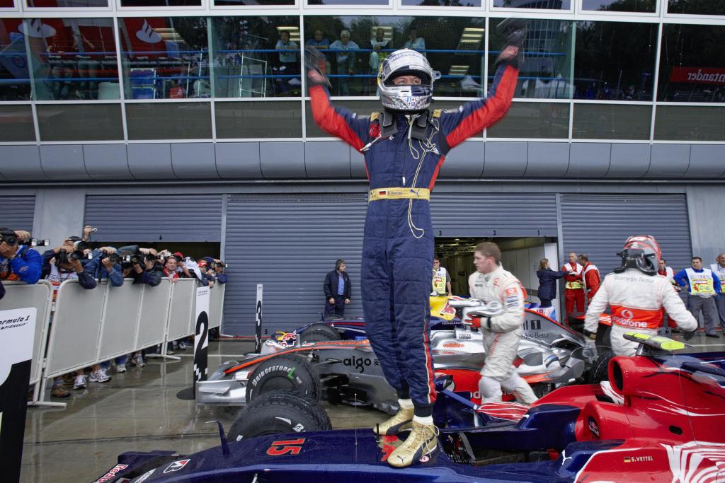 Sebastian Vettel celebrating on his Formula 1 car