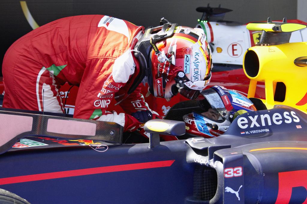 Sebastian Vettel congratulates Max Verstappen