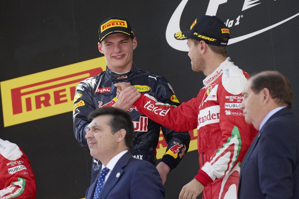 Max Verstappen and Sebastian Vettel shake hands