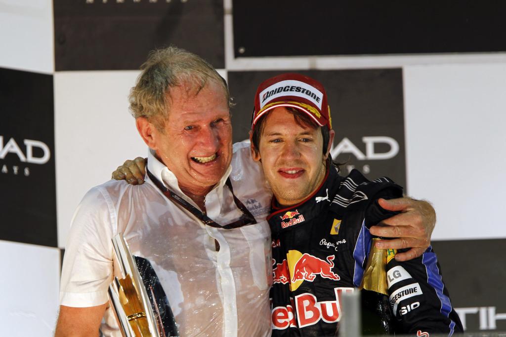 Helmut Marko and Sebastian Vettel soaked in champagne
