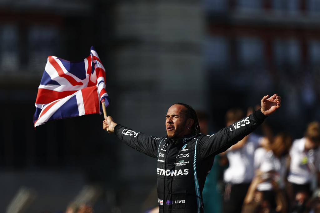 Lewis Hamilton waving a British flag.
