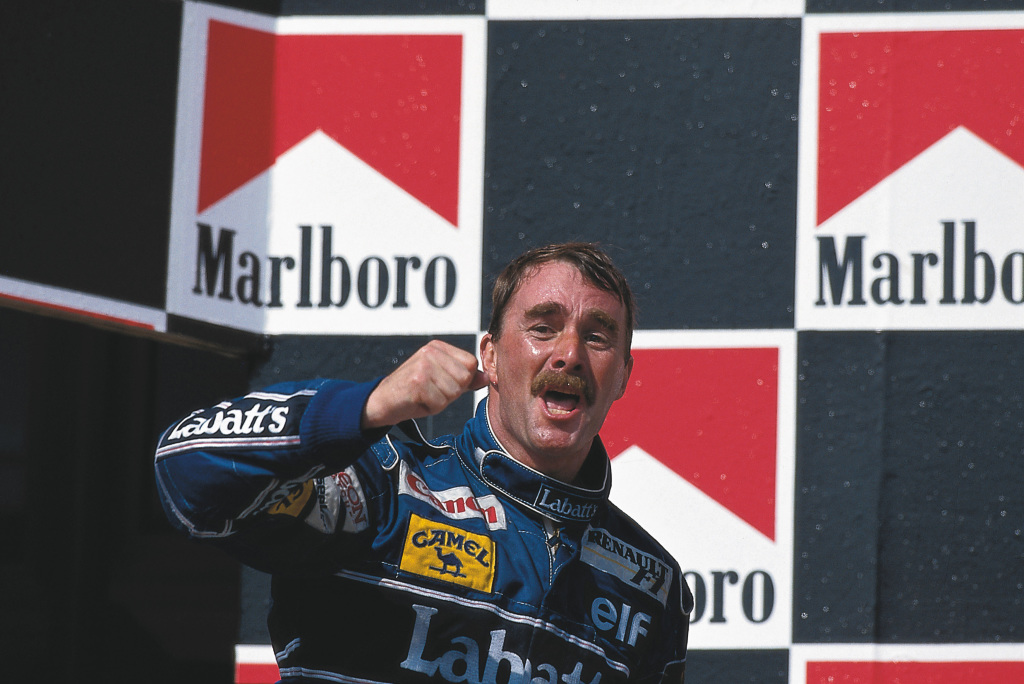 Nigel Mansell celebrates by punching the air